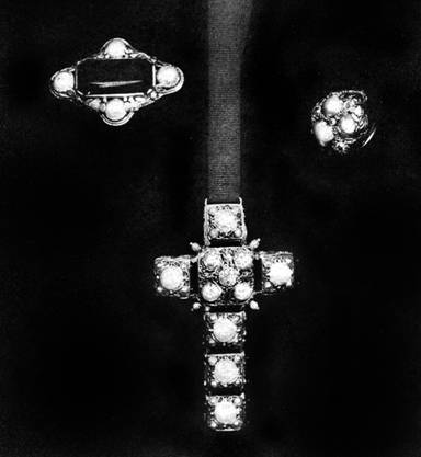 Elaborately wrought cross finished on both sides: suspended  on black ribbon; brooch of simple design; ring of baroque pearls, by Edward E. Oakes