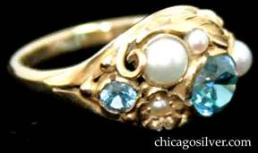 Ring, by Edward Oakes, 18K yellow gold with blue faceted zircons and pearls on large and lovely gold leaf background, with scrolls and beads