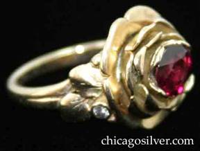 Ring, by Edward Oakes, pink gold, rose petal motif, centering 1.45 carat faceted ruby inside nest of petals, and accented with a small diamond and leaves and beads on each side.