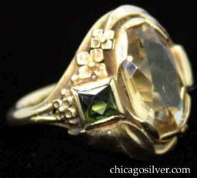 Ring, by Edward Oakes, hand wrought in 14K green gold with central oval faceted citrine, flanked by a square green tourmaline on either side with delicate gold work depicting flowers and leaves.  Beautifully crafted, very delicate.