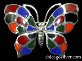 Kalo brooch, butterfly-form, with detailed insect body and antennae surrounded by four-part wings decorated with cloisonn� enamel cells in blue, orange, black, red, and green colors