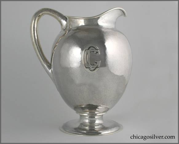 "Kalo pitcher, presentation, large, on round pedestal base.  Egg shaped body with high spout and looping hollow handle.  Applied ""CGC"" mono (Chicago Golf Club).  7-3/4"" W and 9-5/8"" H.  STERLING / HAND BEATEN / AT / KALO SHOPS / PARK RIDGE / ILLS. / 9305"