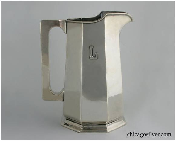 "Kalo pitcher, water, gently tapering paneled form with flat top and bottom square section hollow handle, rising spout, on small foot, with applied ""L"" mono, engraved ""January 10, 1914"" on bottom, applied wire to rim.  Excellent condition, fine hammering.  From the estate of Ruth Langworthy.  9-9/16"" H and 7-7/8"" W.  STERLING / HANDWROUGHT / AT / THE KALO SHOP / G579"