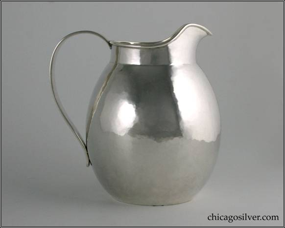 "Kalo milk pitcher / jug, small, egg shaped form on flat bottom with necked in top, slightly flared spout and looping strap handle.  Nicely hammered.  5-1/2"" W and 6-1/8"" H.  STERLING / HAND BEATEN / AT / KALO SHOPS / PARK RIDGE / ILLS. / 9303"