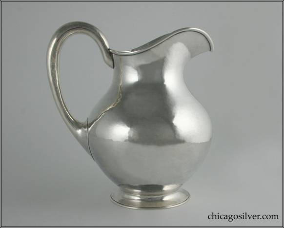 "Kalo pitcher, water with nicely hammered surfaces on pear-shaped form with looping hollow handle and flared foot.  9"" H and 8"" W.  STERLING / HANDWROUGHT / AT / THE KALO SHOP / 2 P / 4-1/2 PINTS"