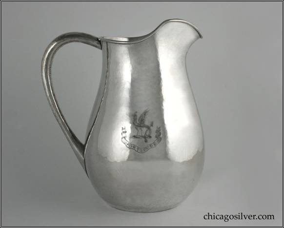"Kalo water pitcher with high looping hollow handle, and applied W / 1884 1909 monogram, engraved dragon and ""FORTITUDE"" on side.  Flat bottom.  Nicely hammered.  Beautiful, fluid shape with attractive spout.  8-3/4"" W across handle and 10"" H.  STERLING / HAND BEATEN / AT / KALO SHOPS / PARK RIDGE / ILLS."