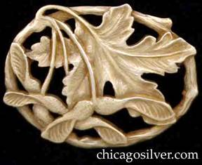 Potter Studio brooch, gold, with maple leaves and winged seeds on oval frame made to look like a curved twig.  Hammered and carved details.  Thick and very heavy.