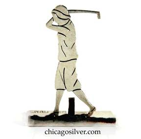 Potter Bentley placecard holder in the form of a female golfer swinging a golf club, handwrought in sterling silver with a split rectangular base that has an upright prong for holding a placecard, and pierced and chased detail