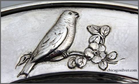 Kalo plate, child's, round, with raised border, repoussé design of songbird on branch with flowers, applied wire on rim -- detail