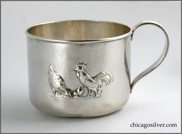 "Kalo cup, child's cylindrical, with round bottom, looping strap handle and applied wire to rim, repouss� rooster and chickens on side, engraved ""James Colvin Causey / Jan. 25, 1918."" on bottom"