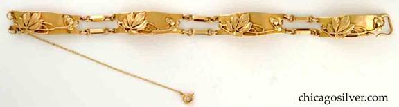 Rokesley bracelet, hand wrought in 14K gold with four swollen rectangular plaques joined by small oval links.  Each plaque with a highly detailed applied water chestnut design with swirling branches in an Art Nouveau style.  Beautifully crafted.  Subtle hammering.
