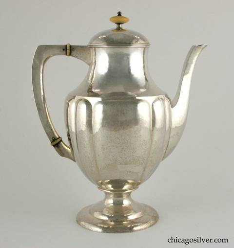 "Kalo coffee pot, fluted, with flat top hollow handle and complementing spout.  Ivory insulators and turned finial.  Keyed lid.  Engraved ""March 3, 1891 Charles H. Sergel = Annie Myers Sergel March 3, 1916"" on the underside.  9"" W and 11"" H.  Marked:  STERLING / HAND WROUGHT / AT / THE KALO SHOPS / CHICAGO / AND / NEW YORK / 961 / L"