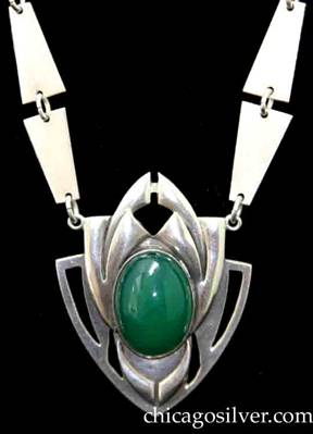 Art Silver Shop necklace, composed of 20 hammered trapezoidal links connected by small loops, centering a pendant with a large green oval stone.  The links are arranged in pairs with the wide ends together.  The pendant is shield-shaped with pierced geometric details extending from the curved sides and at the top, and applied curving cutout forms centering a large oval green bezel-set cabochon stone.