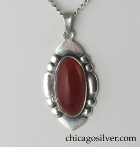 Art Silver Shop pendant on chain, oval, with repoussé sides, triangular bezel, and oval bezel-set cabochon carnelian stone with open back.  On delicate replacement chain.