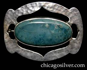Art Metal Studios brooch / pin, oval, with ends that have small lobes top and bottom, centering large bezel-set oval cabochon green-blue stone, with curving pointed cutouts surrounding it on all four sides.  Heavily hammered surface.