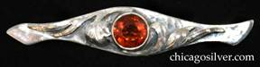 Art Silver Shop brooch / pin, long, with rounded center tapering away from the middle then flaring out again at the ends, which are curved and pointed.  Large round bezel-set orange faceted topaz stone at center flanked on both sides with chased and applied leaves.  Hammered surfaces.