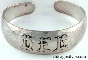 "Art Metal Studios bracelet, with open back and tapering rounded ends, applied ""DEC"" mono in oriental style, nice hammering."