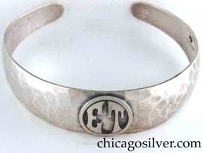 "Art Metal Studios bracelet, with open back and tapering rounded ends, applied ""ET"" mono in circle, nice hammering."