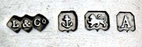 British marks, like this from Liberty & Co., indicate the maker, the city assay office (anchor means Birmingham), quality (lion rampant means sterling) and date (A is 1925)