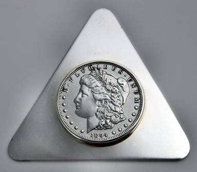 90% silver coins are sometimes used in sterling items -- this paperweight by Leonore Doskow is a good example.