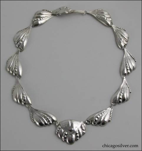 Peer Smed necklace, silver, composed of ten links formed in the shape of raised leaves with circular accents, centering a slightly larger pentagonal pendant in similar decoration