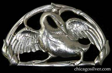Peer Smed brooch / pin, oval with flat bottom, large and heavy, in the shape of a swan with outstretched wings on a cutout frame with floral decoration.  Nicely detailed chasing.