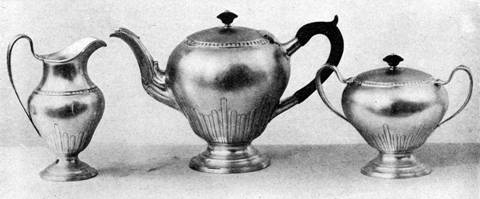 Handwrought tea set with reed fluting by Arthur J. Stone