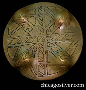 Pin, brass, round, with acid-etched design somewhat resembling ladders or an abstract snowflake.