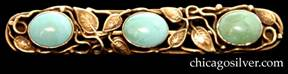 Brooch / pin, gold, long and narrow, with rounded corners, and three oval bezel-set turquoise stones on thick flat wire frame, surrounded by veined, detailed leaves and gold wirework vines and beads.