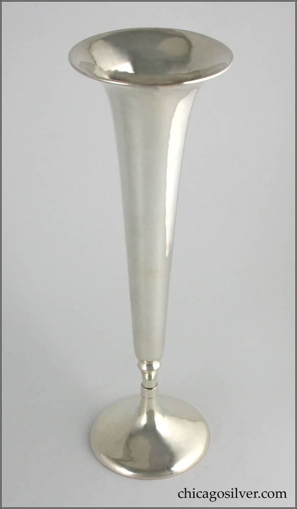 "Kalo vase, large trumpet, broad circular base tapering to a slender trumpet form, flaring at rim.  Hammered surface.  Engraved ""Christmas 1923 From Helen"" on underside.  14-1/2"" H and 4-1/2"" W.  Marked:  STERLING / HANDWROUGHT / AT / THE KALO SHOP / K313ML"