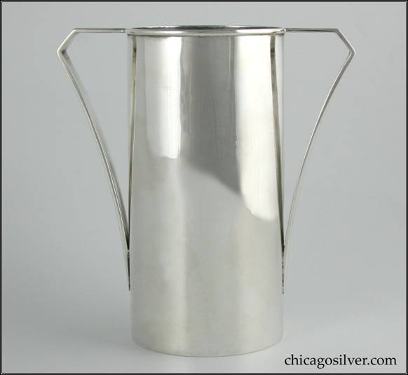"Kalo vase, cylindrical, with flat strap handle that creates a horizontal plane with the rim, then angles down and gracefully curves to meet the body.  Applied wire to rim.  Simple but classic, elegant form.  In excellent shape.  6-1/4"" H and 5-7/8"" W.  Marked:  STERLING / HAND BEATEN / AT / KALO SHOPS / PARK RIDGE ILLS.  / 9544"